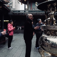 Offer a prayer at Lungshan Temple